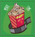 cardboard box with popcorn and reel of film vector image vector image