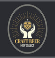 beer hop in hands vintage logo on black background vector image