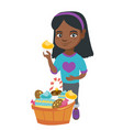 girl holding a cupcake and stroking her belly vector image vector image