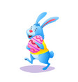 happy easter bunny in yellow shirt with egg vector image vector image