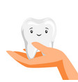 smiling tooth on hand vector image vector image