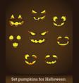 jack o lantern pumpkin faces glowing on brown vector image vector image