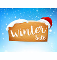 winter sale on wooden sign and snow fall 001 vector image vector image
