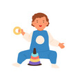 cute funny boy playing with pyramid toy vector image vector image