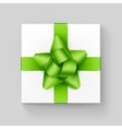 White Gift Box with Green Ribbon Bow on Background vector image vector image