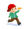 happy kid playing with paper airplane vector image vector image