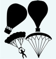 Hot air balloon in the sky and man jumping with pa vector image