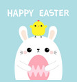 happy easter bunny holding pink painting egg vector image vector image