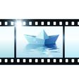 Photo film with origami boat vector image vector image