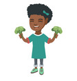 little african girl laughing and holding broccoli vector image