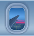 airplane window at night night city from sky view vector image vector image