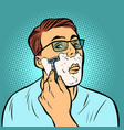 man shaving razors vector image vector image