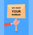 we want your feedback hand hold board banner for vector image vector image