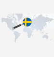sweden flag in magnifying glass vector image