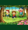 Three kids on swings in the woods