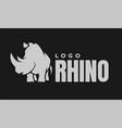 african rhino silhouette logo symbol on a dark vector image vector image