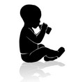 silhouette baby sitting drinking from baby bottle vector image