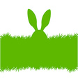 Easter bunny ears on grass greeting card vector image