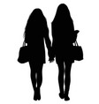 silhouette of two walking girls holding hands vector image vector image