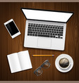 laptop and office stationery on the table vector image