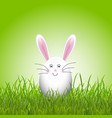 cute easter egg bunny in grass vector image vector image