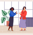 two women friendly chatting in office panoramic vector image