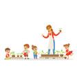 biology lesson in kindergarten children looking vector image vector image