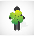 black silhouette of a man holds the four-leaf vector image