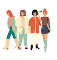 four young women in autumn clothes standing vector image vector image