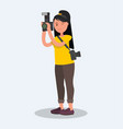 woman photographer holding a camera vector image vector image