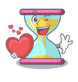 with heart modern hourglass on the table cartoon vector image vector image