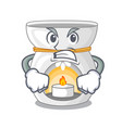 angry aroma lamp with burning candle mascot vector image