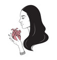 beautiful brunette with heart in her hands vector image vector image