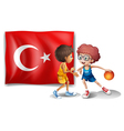 Two boys playing basketball in front of the flag vector image vector image