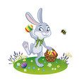 the easter bunny with a basket full of painted vector image