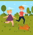 kids playing with dog in the park boy and girl vector image