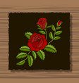 embroidery roses and sprigs on a dark flap cloth vector image vector image