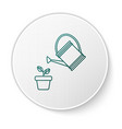 green watering can sprays water drops above plant vector image vector image
