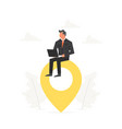 businessman with a laptop sitting on a big map vector image vector image