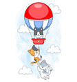 cute kittens hanging on hot air balloon flying vector image
