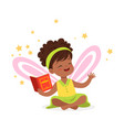 sweet african little girl with a book dreaming vector image vector image