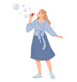 young woman blowing soap bubbles vector image vector image