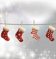 Hanging christmas socks on a clothesline vector image