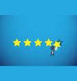 businessman holding gold star for rating vector image