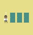 Businessman standing beside three doors
