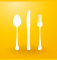 spoon fork and knife on yellow background vector image vector image