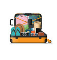 open suitcase packed for travel vector image vector image